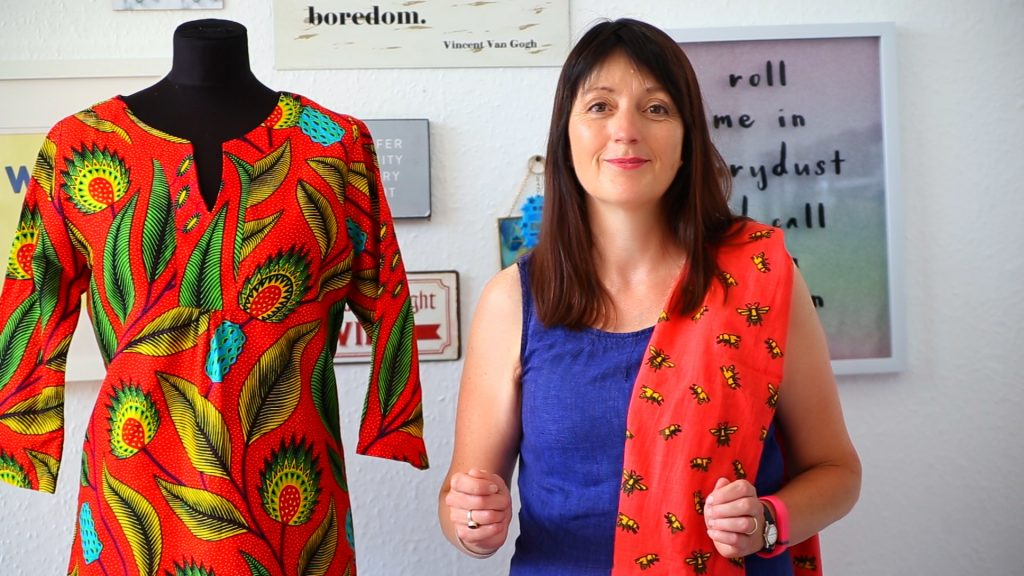 Jo Salter, founder of Where Does It Come From? with a prototype of the new tunics